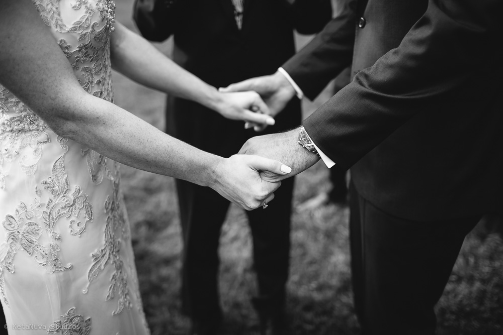 Perona Farms wedding - bride and groom holding hands.