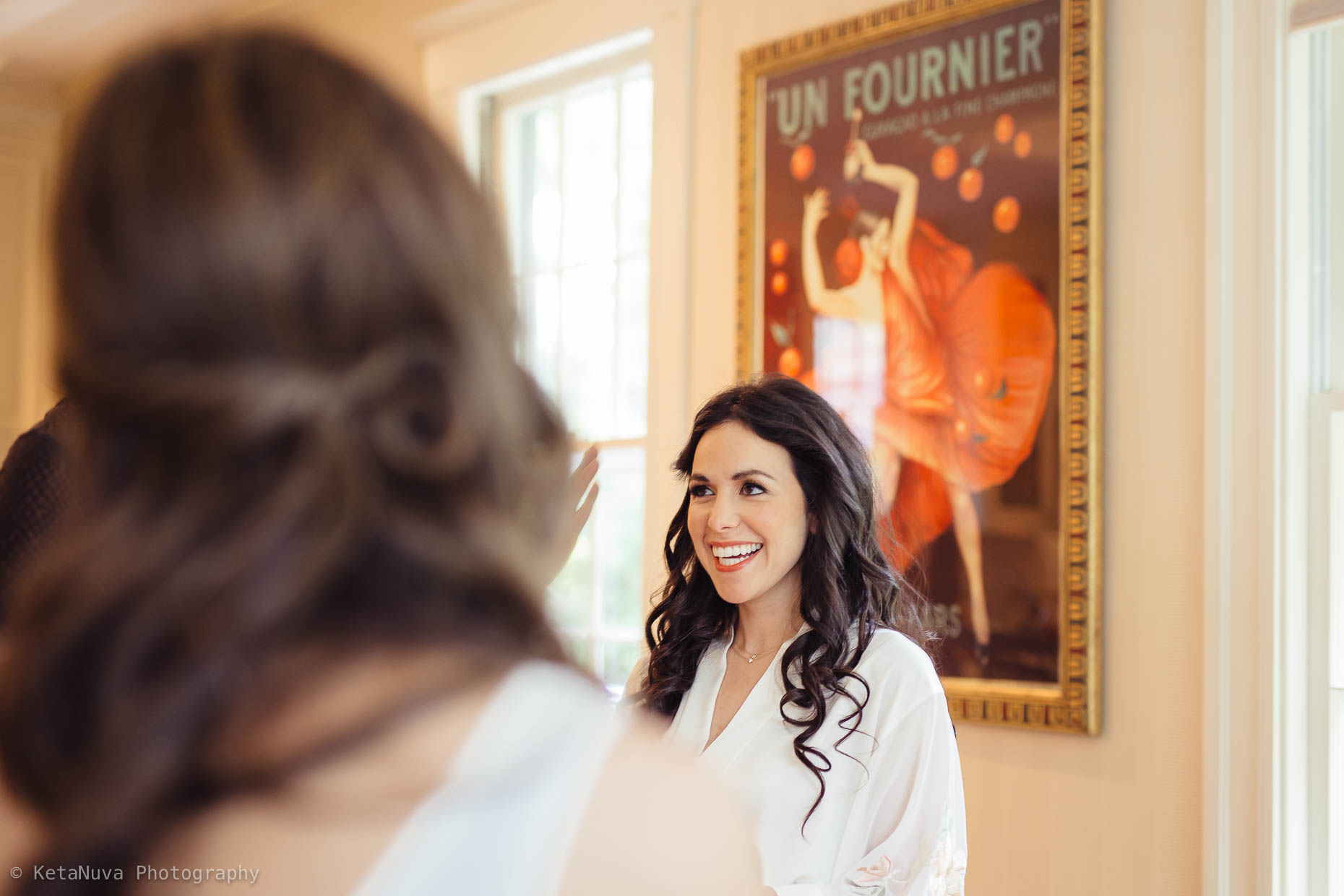 "A candid moment while the bride was getting ready."" width=""1860"" height="