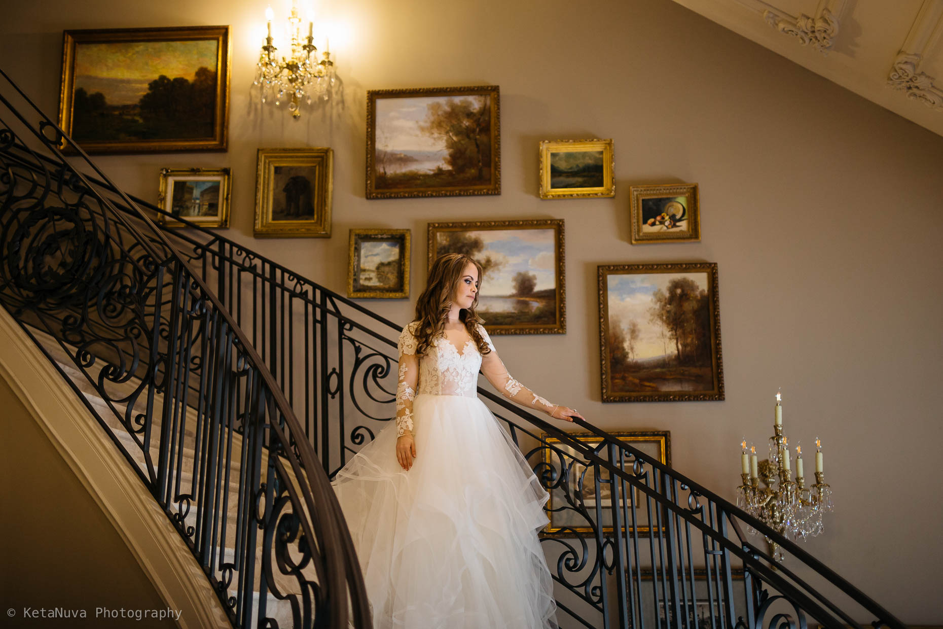 The first look- bride walking down the lovely stairs - Park Chateau Estate wedding