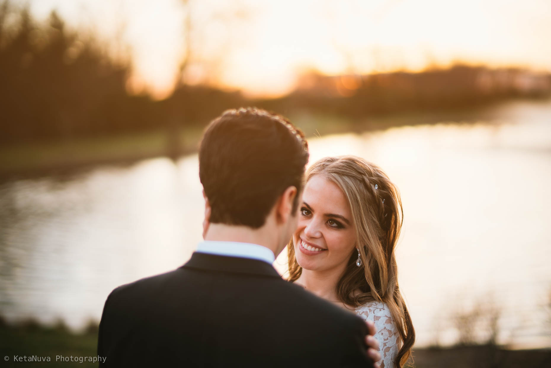Beautiful golden light photograph of Sara and Bryan at their Park Chateau Estate wedding